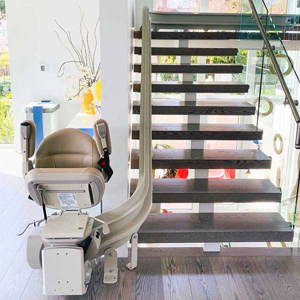 Bruno Elite Curved stairlift on wooden steps